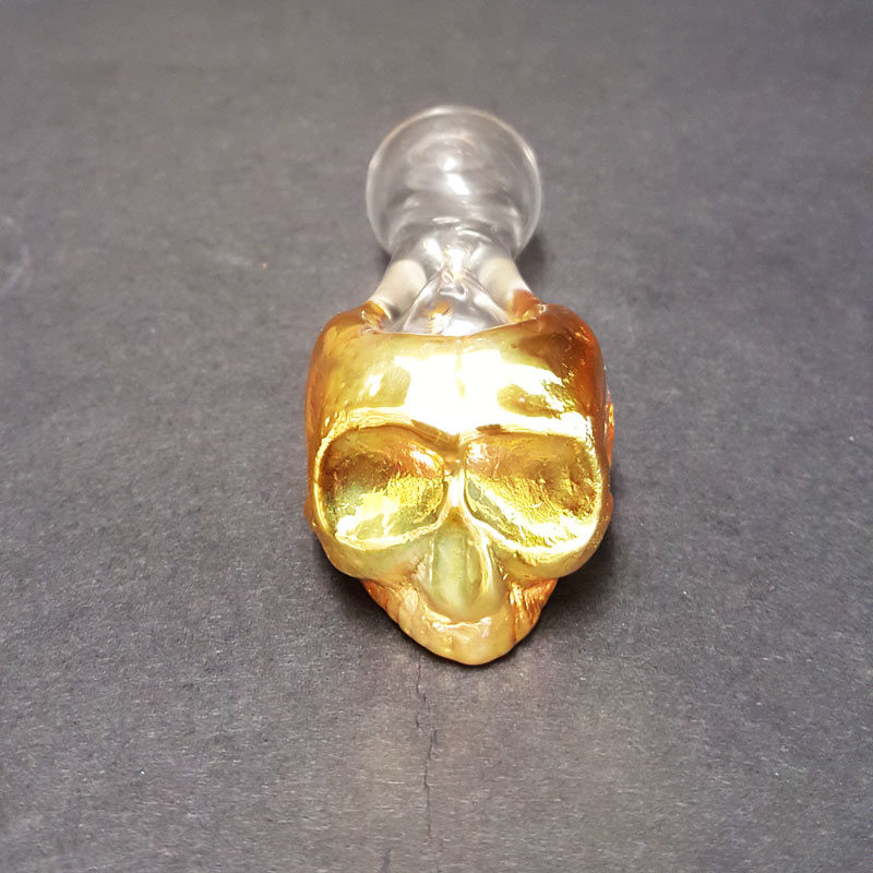 showing the shape of this handmade glass skull pipe.