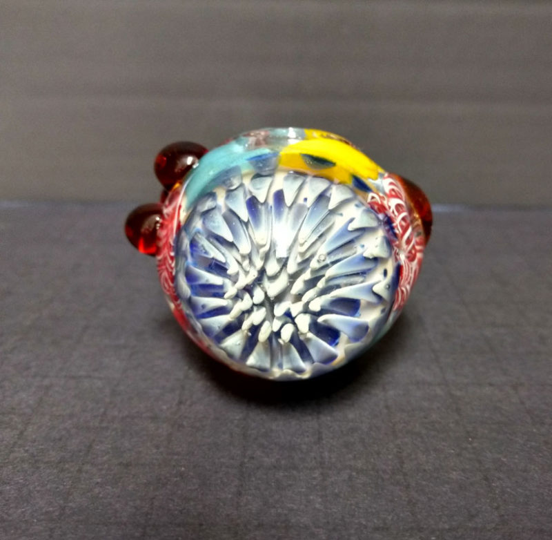 glass beads and implosion are shown.|Close up view of the glass implosion effect on front of this heavy duty glass pipe.|Close up view of the bowl and glass beads on this glass hand pipe.