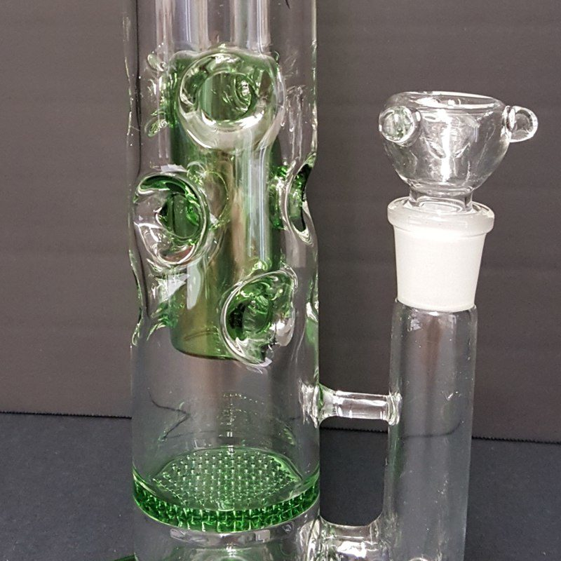 sturdy base.|Front view of the swiss cheese design water pipe showing the 18mm slide and wide